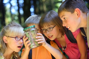 bigstock-Children-looking-at-bug-in-jar-14086556